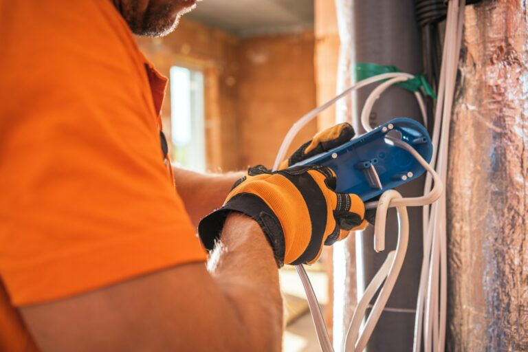 Electrician Preparing Electric Outlet