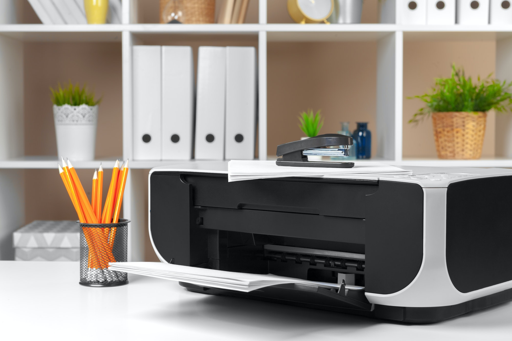 Printer, copier, scanner in office. Workplace. Close up.